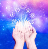Healing hands. Female hands with seven symbol of chakra like a conncept for healing energy royalty free stock images