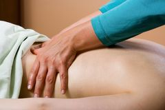 Healing Hands On Back. Woman's back receiving a massage. Could be used for spas, massage therapy ads, or tension relief articles royalty free stock photography