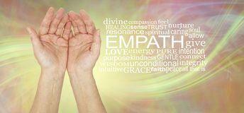 The healing hands of an empath Word Cloud. Pair of female hands gently cupped beside an EMPATH word cloud against a lemon laser light swish energy background royalty free stock photography