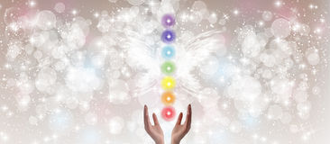 Healing Hands and seven chakras Stock Photos