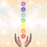 Healing Hands and seven chakras Stock Photography
