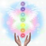 Healing Hands and seven chakras Stock Photos