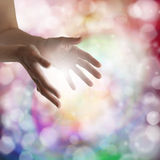 Healing hands and sparkling energy Stock Photo