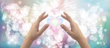 Healing Hands. On a sparkling pastel coloured background Royalty Free Stock Photos
