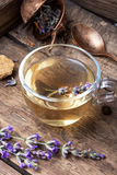 Healing, herbal tea with lavender. Herbal tea with inflorescence lavender in a glass cup in a rustic style Stock Photos