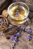 Healing, herbal tea with lavender. Herbal tea with inflorescence lavender in a glass cup in a rustic style Royalty Free Stock Photography