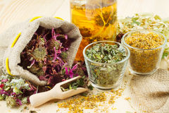 Healing herbs and healthy tea on  table. Healing herbs and healthy tea on wooden table, herbal medicine Royalty Free Stock Photos