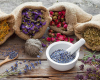 Healing herbs in hessian bags and mortar of lavender. Healing herbs in hessian bags and mortar with dry lavender, herbal medicine stock images