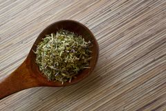 Many different medicinal herbs in wooden spoon. Royalty Free Stock Photo