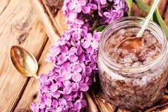 Healing lilac flower jam. Homemade spring jam of lilac petals.Health food stock image