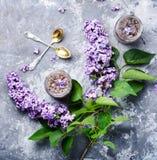 Healing lilac flower jam. Homemade spring jam of lilac petals. Medicinal jam royalty free stock photos