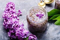 Healing lilac flower jam. Homemade spring jam of lilac petals. Medicinal jam stock photo