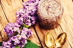 Healing lilac flower jam. Homemade spring jam of lilac petals. Medicinal jam royalty free stock photography