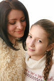 Healing mother-daughter relationships. White young women with black hair bob with love and warmth looks at his daughter. a girl with a scythe and a white sweater Royalty Free Stock Photos