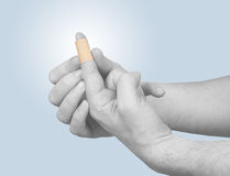 Healing plaster on finger. Stock Image