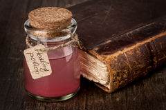 Healing red potion. Close up Royalty Free Stock Photography