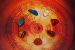 Healing stones. Esoteric stones in a circle on beautiful astrological wheel like background stock image
