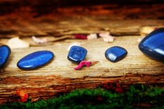 Healing stones on old wood Stock Photo