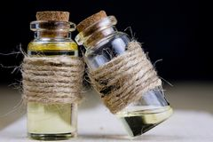 Healing syrup during influenza. Specificity of medicinal ingredi. Ents in a small bottle. Light background Stock Image