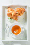 Healing tea with croissant. In sunny summer day Stock Image