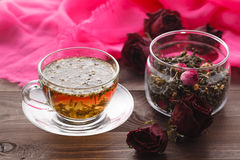 Healing tea with herbs and rode hip Stock Images