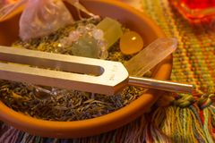 Healing tuning fork and crystal stone on table . Stock Photo