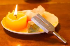 Healing tuning fork and crystal stone on table . Royalty Free Stock Photography