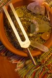 Healing tuning fork and crystal stone on table . Stock Image