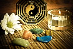 Healing Yin yang. Yin yang with candle, healing stones and white flower Stock Images