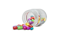 Health. Capsules in a small recipient of glass Royalty Free Stock Image