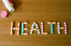 Health - 2. The word health made of coloured vitamins and a bottle Royalty Free Stock Images