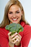 Health. Young happy woman with broccolis royalty free stock photography