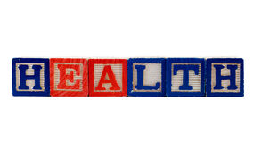 Health. The word health, spelled using colored letter blocks, isolated against a white background Royalty Free Stock Image