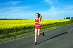 Health. An image of young girl running on the asphalt road Stock Photography