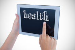 Health against woman using tablet pc Royalty Free Stock Photo