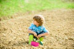 Free Health And Ecology. Small Kid Planting A Flower. Happy Child Gardener. Botanic Worker. Spring Season. Ecology Life. Eco Stock Photo - 154433530