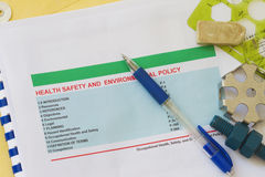 Health ans safety policy. Health,safety and environmental policy with engineering materials royalty free stock photography