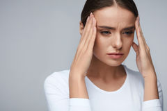 Health. Beautiful Woman Having Strong Headache, Feeling Pain Royalty Free Stock Image