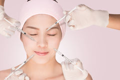 Health and beauty concept - Beautiful woman Having Rejuvenating Injection against the Wrinkles Royalty Free Stock Image