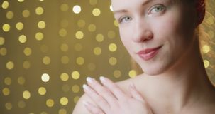 Health and beauty concept. Close-up of a beautiful woman cares about her shoulder stock footage