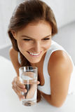 Health, Beauty, Diet Concept. Woman Drinking Water. Drinks. Wate. Health, Beauty, Diet Concept. Close-up Portrait Of Happy Young Woman Drinking Refreshing Pure Stock Image