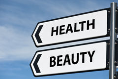 Health and beauty sign post stock photography