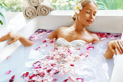 Health, Beauty. Woman Spa Body Care. Relaxing Flower Rose Bath. Health And Beauty. Woman Spa Body Care Procedure. Closeup Attractive Sexy Blonde Female In Bikini Royalty Free Stock Images