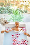Health, Beauty. Woman Spa Body Care. Relaxing Flower Rose Bath Stock Images