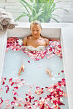 Health, Beauty. Woman Spa Body Care. Relaxing Flower Rose Bath Royalty Free Stock Photography
