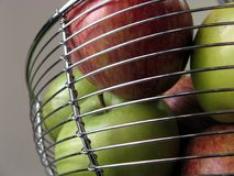 Health behind bars. Landscape photo of apples in a bowl stock image