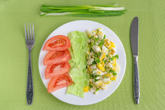 Health breakfast. Scrambled eggs, pita bread, tomatoes and onions for breakfast Stock Photography