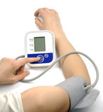 Health Care. Female hands with blood-pressure meter isolated over white Stock Image