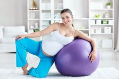 Health-care. A pregnant woman with a ball at home Royalty Free Stock Photography