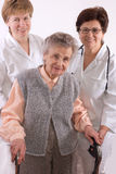 Health care. Workers and elderly woman needs help Royalty Free Stock Photos